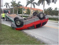 Red car flipped over